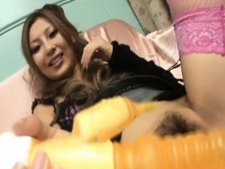 Japanese milf Shiho Kano fucks the brush puristic twat with regard to a big toy