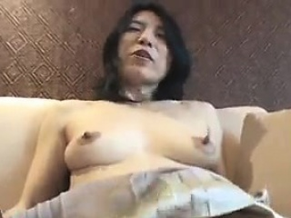 Horny mature rubs her hairy twat