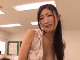 Striking asian Reiko Kobayakawa is cuddling her huge boobs