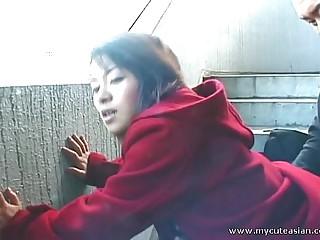 Cute Asian giving a hot alfresco blowjob